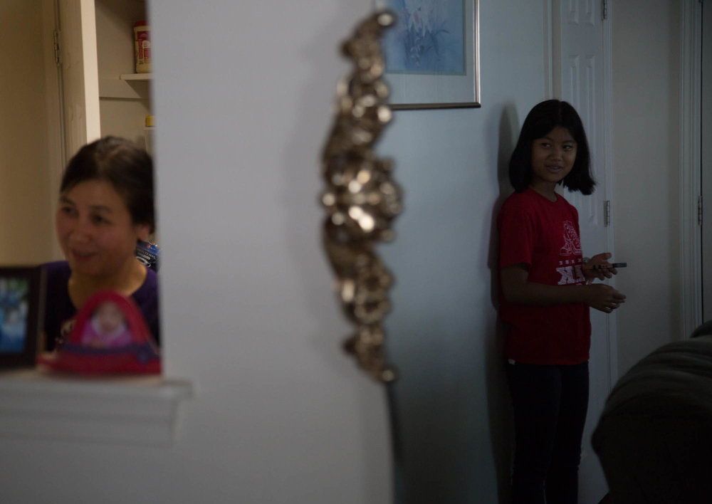 """Lwin calls in her elder daughter, Shun Le Win, 12, from her room to speak to her in Burmese. """"My older daughter is learning the violin. She's great, she's good,"""" she said. Both San San and Shun are now U.S. citizens. Her younger daughter, May Thu Win, 10, is an American citizen by birth. """"We had to memorize the answers to 100 questions, and they asked us 6,"""" Lwin said of the process of getting her citizenship. """"It was more expensive for my daughter."""" Her husband has his green card."""