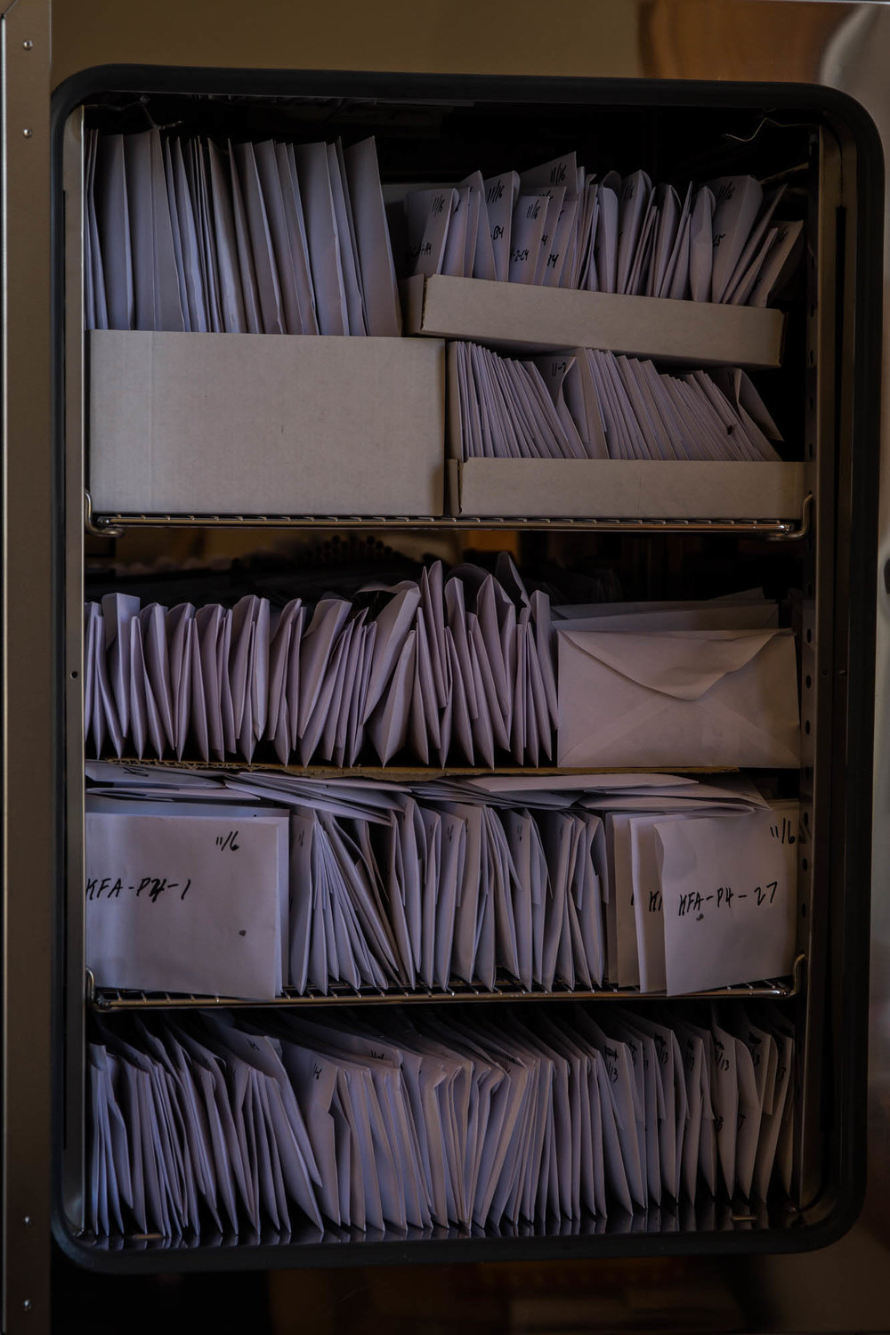 Envelopes stuffed with tree clippings are kept in a drying oven in the Upper Mountain Research Center. After drying out the clippings, they can be weighed to discover water content, which Owens uses in his research.