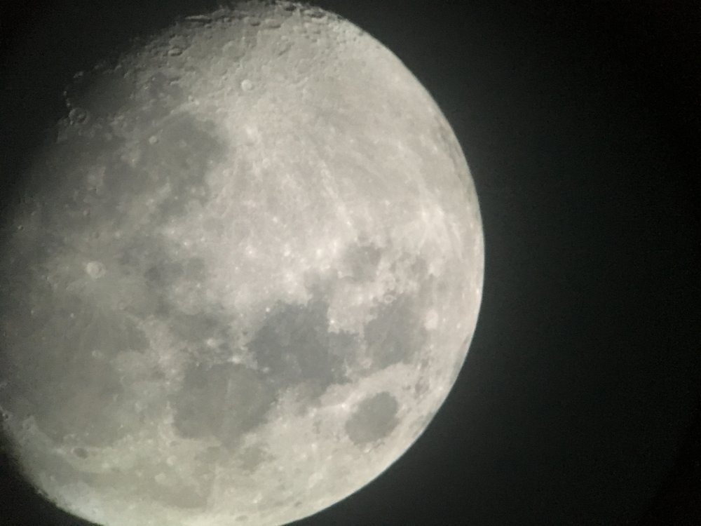 A photo of the Moon taken through the ocular lens of the Ralph M. Medjuck Robotic Telescope. Photo: Yuki