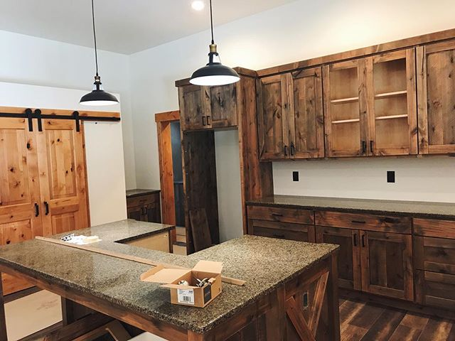 This kitchen is coming together nicely! The mix of woods with the farm house light fixtures is making this one of our favorite kitchens yet. Check out Facebook for more photos!