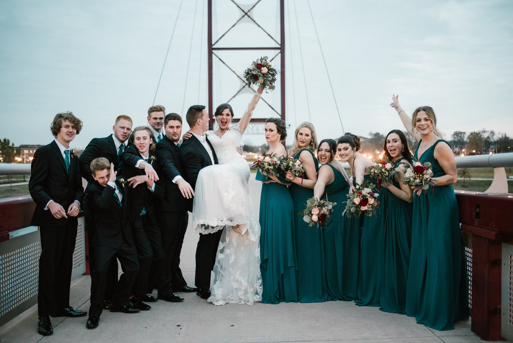 bridal party fun shot at mishawaka river walk