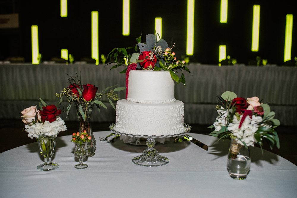 wedding cake setup with flowers