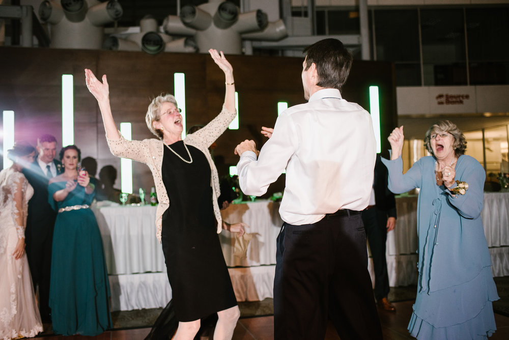 guests having fun dancing at wedding reception