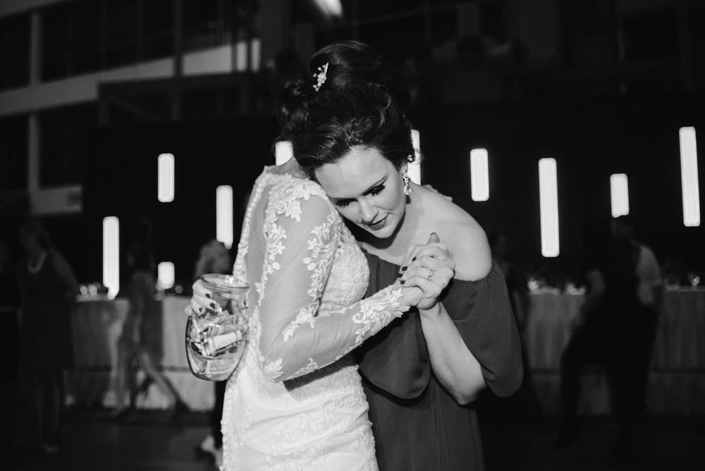 bride and bridesmaid dancing