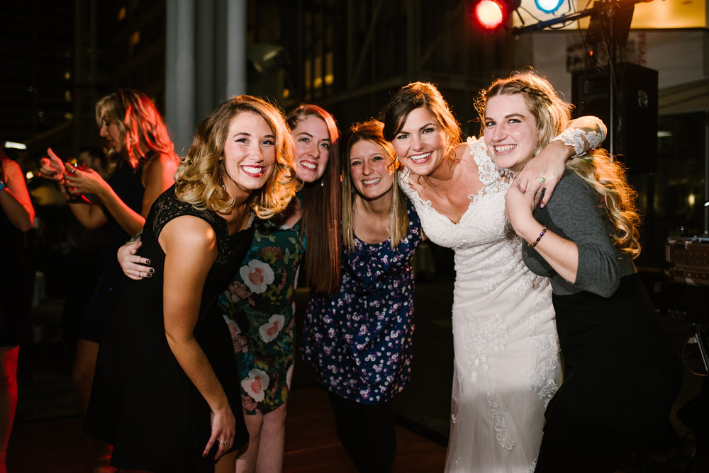 bride posing for picture with guests