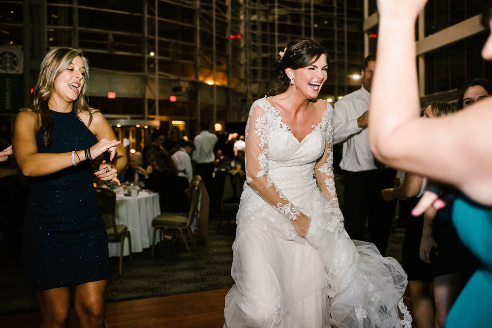 bride laughing on dance floor at reception