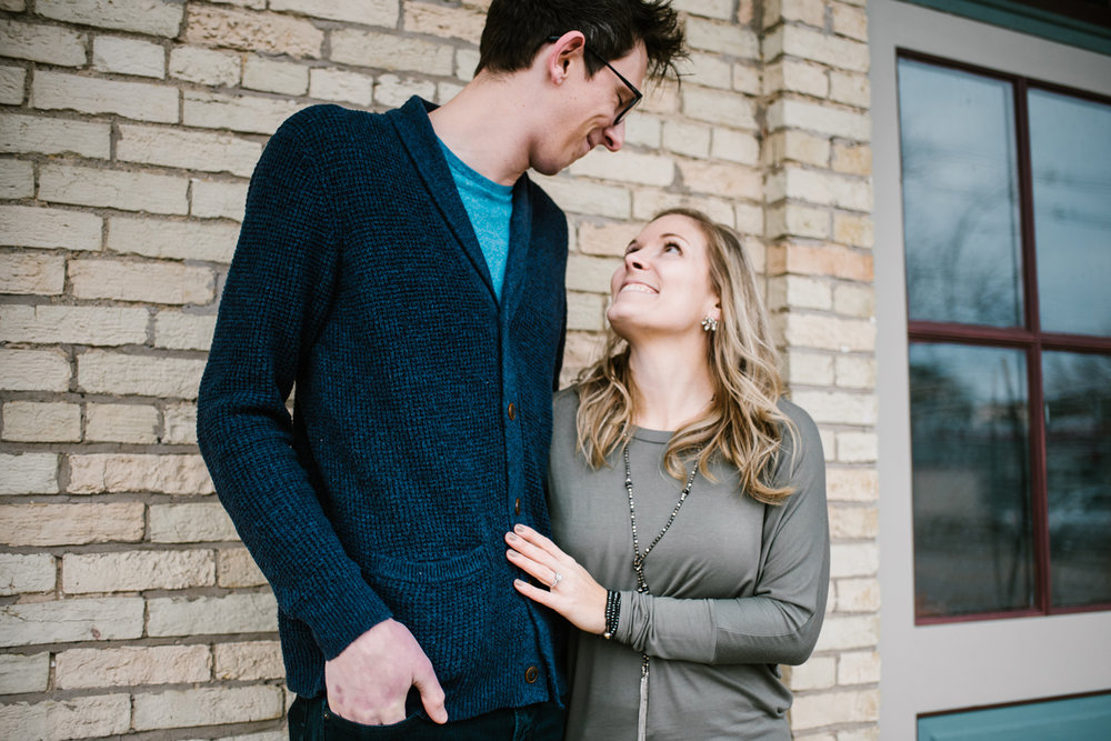 couple with height difference smiling and looking at each other