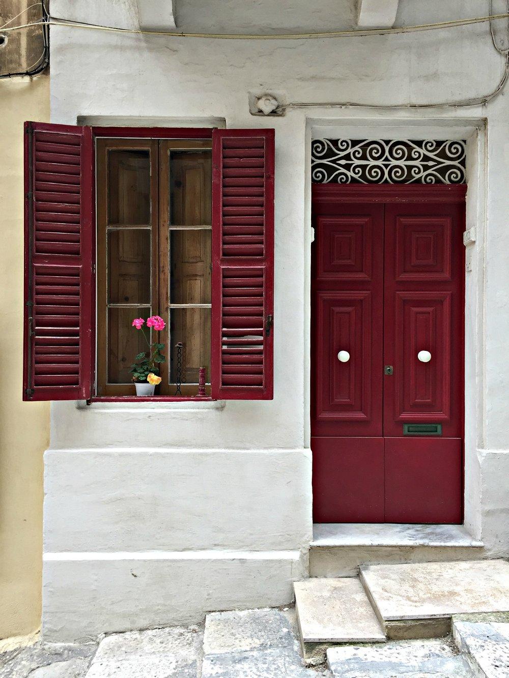Red door and window in Valletta Malta