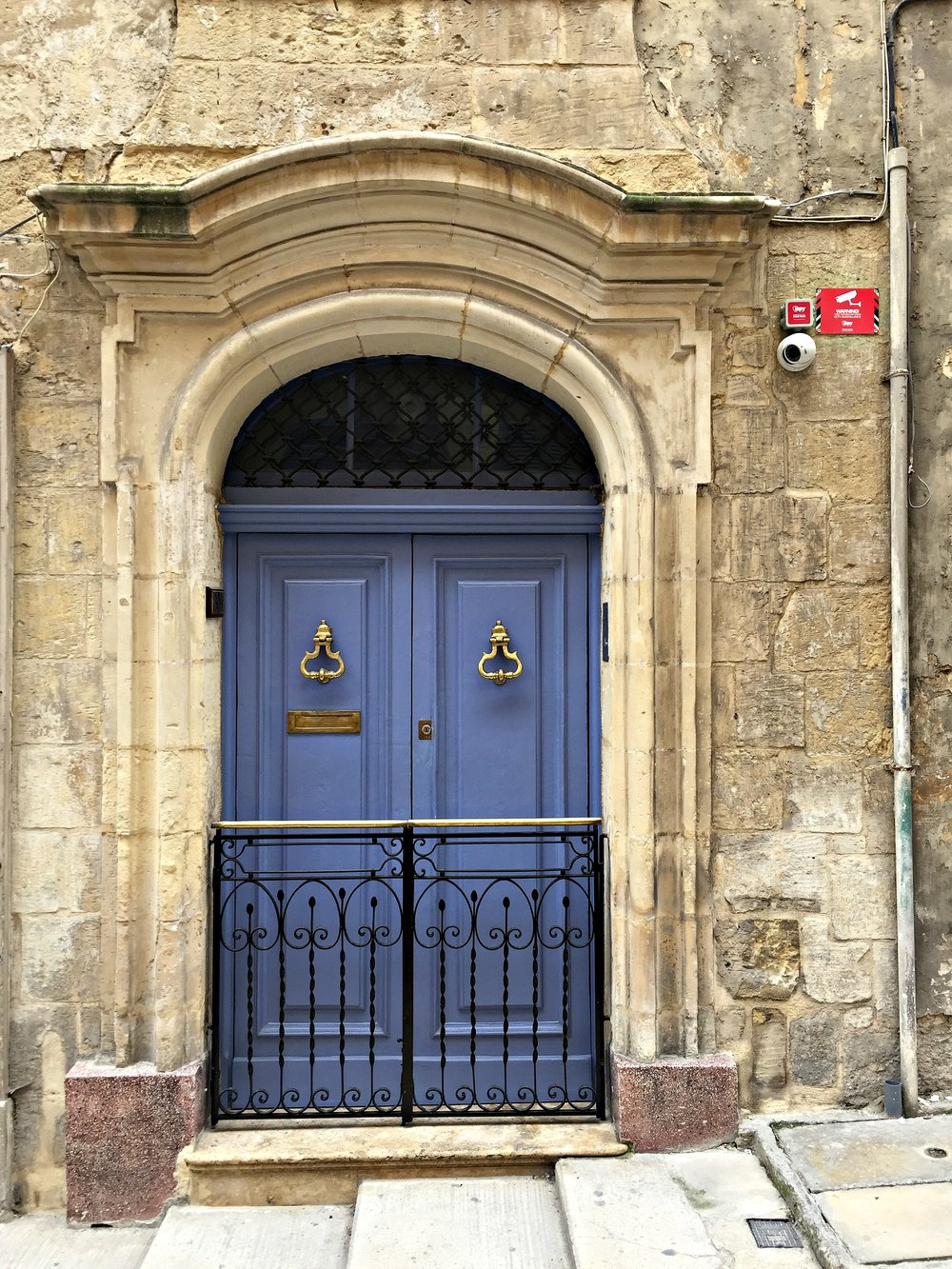 Blue door gold door knobs Valletta Malta