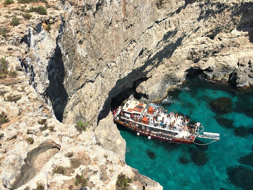 malta sea cave tourist boat