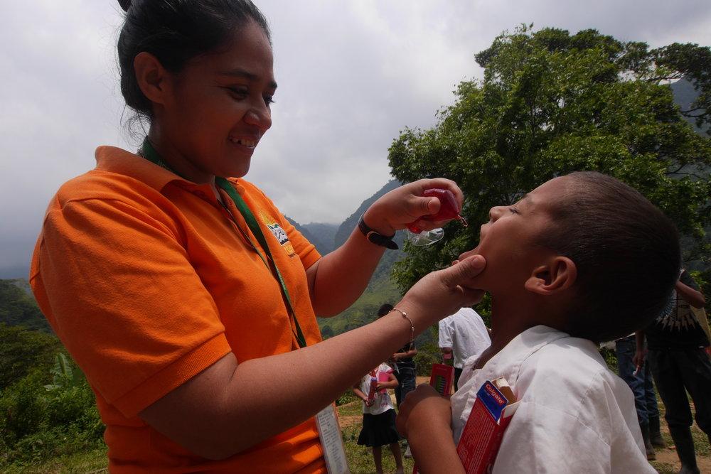 Predisan Nurse Aury Navarro administers vaccine in a clinic in Honduras.