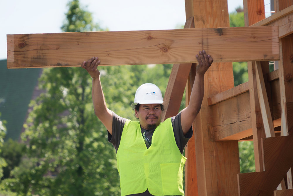"Construction worker holds up a piece of ""Scaffold"" during its dismantling. Photos by Lorie Shaull."