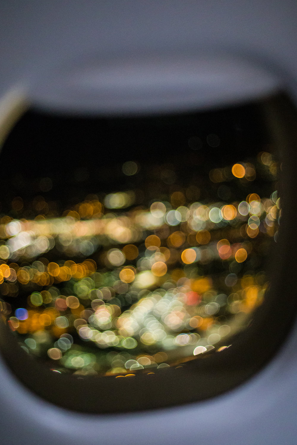 I really don't like flying but I was able to find beauty in these out of focus city lights. A beautiful distraction.