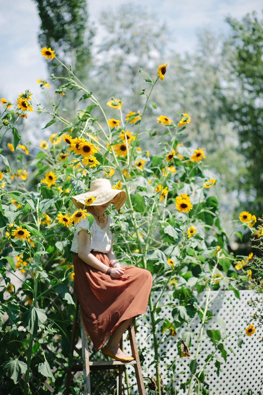 Erika Eddington by Ashley Thalman. Woman in sunflowers.