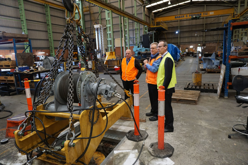 Picture courtesy of NSW Department of Industry - Paul Clark, shows right to left: Peter Scott, Bob Findlay and Malcolm Cazier inspecting a functional and load test being conducted on a spare hoist assembly prior shipping to our customer.