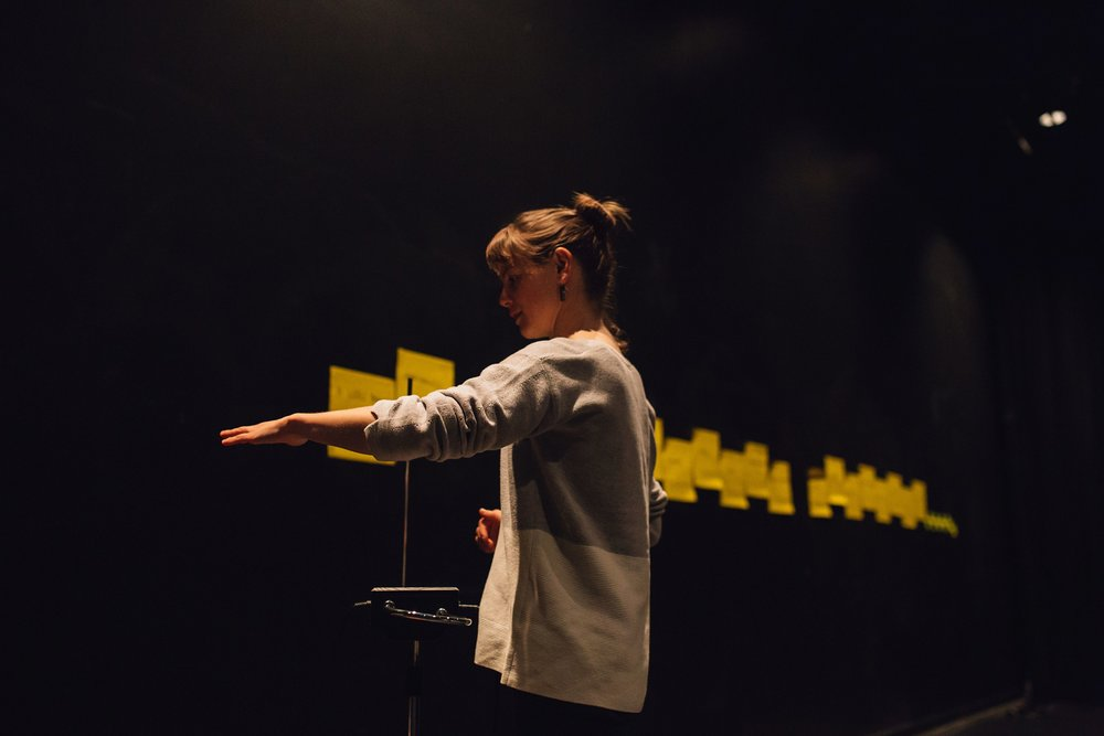 Performer Georgina Beaty playing a theremin