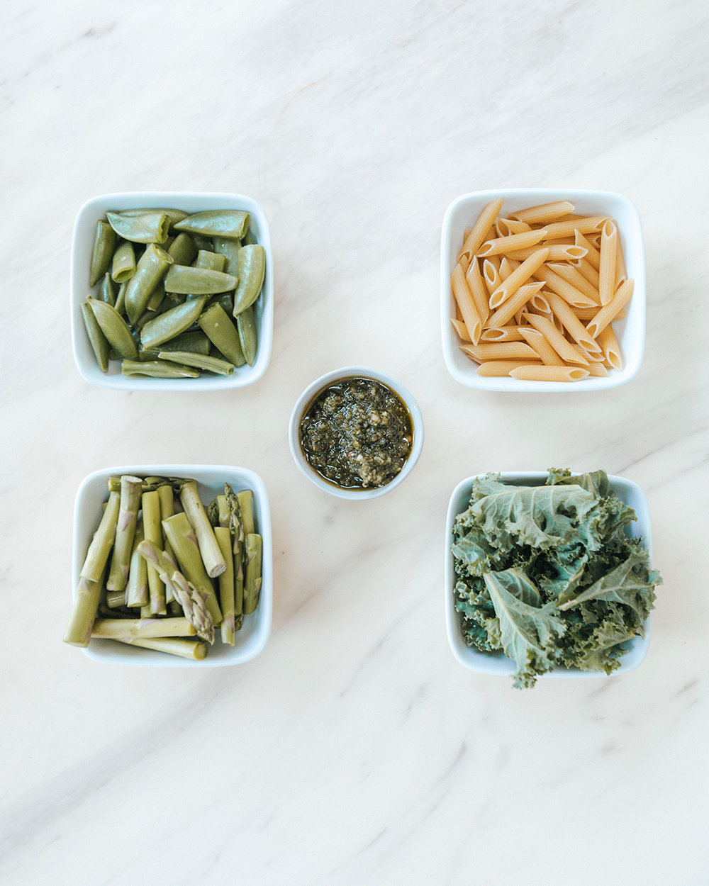 The-Oily-Home-Companion-Recipe-Pesto-penne-gluten-free-gf-pasta-spring-vegetables-asparagus-kale-garlic-basil-lemon-vitality-essential-oil-pesto-Summer-Spring-Dish-Meal-Ingredients.jpg