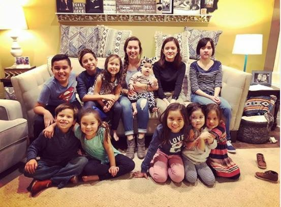 All twelve of my grandkids with diverse cultural backgrounds including Japanese, Filipino, Honduran, and European.