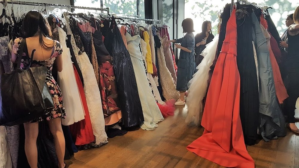 Racks of evening dresses