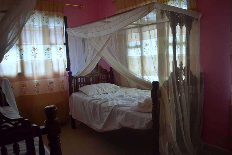 Our room, mosquito nets and all
