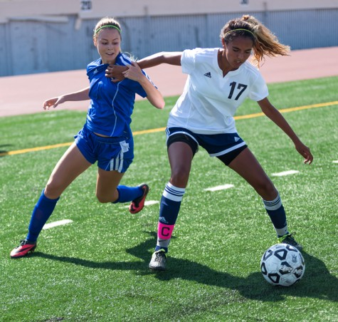 Santa Monica College Corsair, Paige Begell (#2), fights for possession of the ball against El Camino College, Ashley Mercado (#17), during the match on September 4, 2015 at Santa Monica College in Santa Monica, California. Santa Monica College went on to win the game with the score of 2-1.