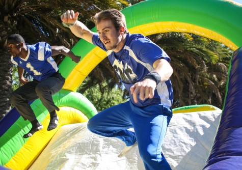 Students race through the bouncy house during club row on Thursday at Santa Monica College. Participants were greeted with refreshments after competing.