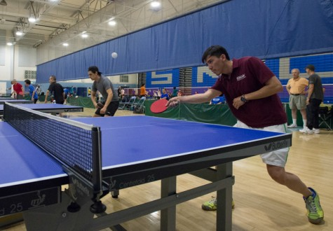 Participants warm up before the RR Tournament held at the Pavilion Gym on Sunday at Santa Monica College.