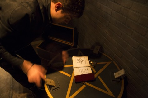 "Ruslan Balashov, co-owner of Maze Rooms, demonstrates one of the puzzles used in the ""Castle"" themed maze at the South La Brea location on Tuesday in Los Angeles, California."