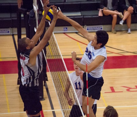 Santa Monica College Corsairs freshman outside hitter, Paddy Pan (26) (right), is blocked by Los Angeles Pierce College sophomore setter, Isaiah Williams (8) (left), during the first set of the Corsairs' 3-1 victory over the Brahmas on Friday at the South Gym at Pierce College in the Woodland Hills neighborhood of Los Angeles, Calif. The Corsiars did not allow the Brahmas within for points during the game and won 25-15.