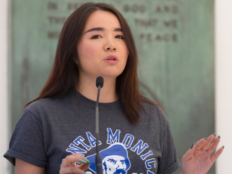Micca Cao, candidate for AS Director of Student Advocacy at Santa Monica College, addresses the students at the debate held at the SMC clock tower quad area on Thursday.