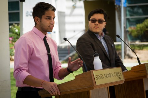 Adrian Restrepo (left), candidate for AS Vice President, discuses problems with the campus as his opponent Yighan Tang (right) looks on and waits for his turn to speak during the debate.