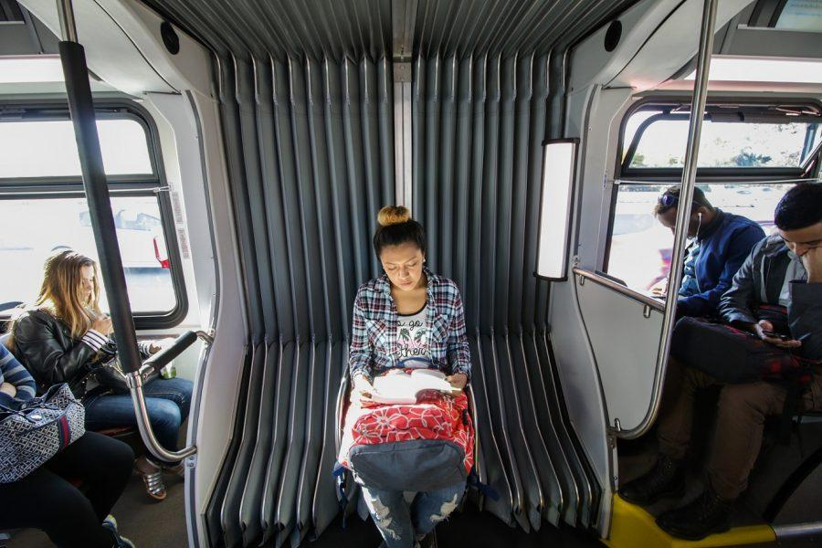 Brenda De Angel, a student at Santa Monica College, and member of the FLVR program maximizes time by reading on her hour long commute to campus on March 15, 2016.