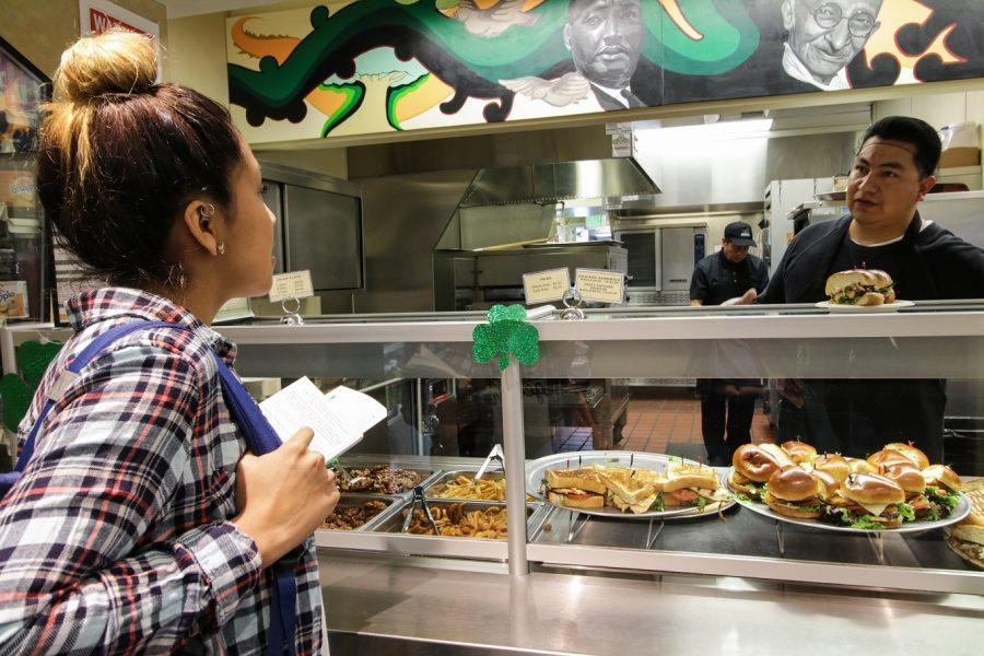 Brenda De Angel asks about options at Eat Street using her 5 dollar voucher from the FLVR program on SMC campus in Santa Monica Calif. on March 15, 2016.