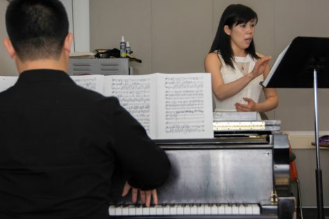 Chinatsu Kiyama (right) rehearses during an Opera Club meeting