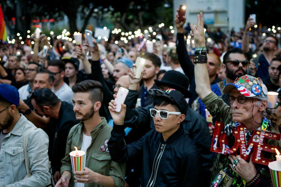 The crowd looks on as the names of the victims of the Orlando shooting are read at vigil outside of City Hall in Los Angeles, Calif.