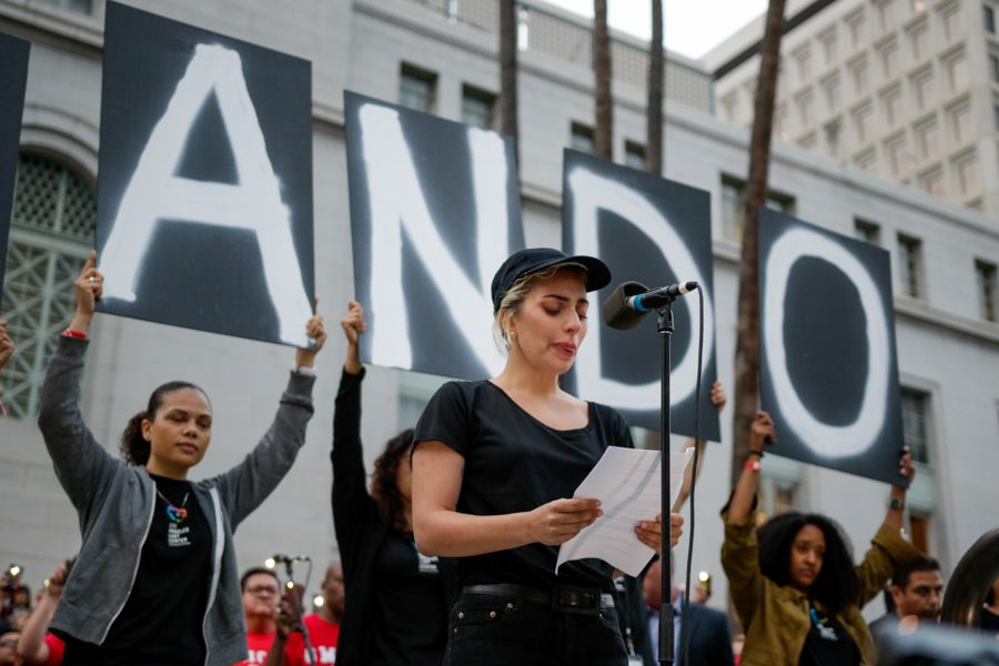 Lady Gaga reads names of the victims of the Orlando shooting at a vigil outside of City Hall in Los Angeles, Calif.