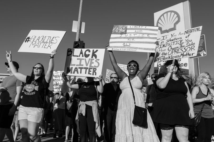 Protesters wielded signs and marched on the sidewalk in a peaceful protest in Los Angeles on July 10.