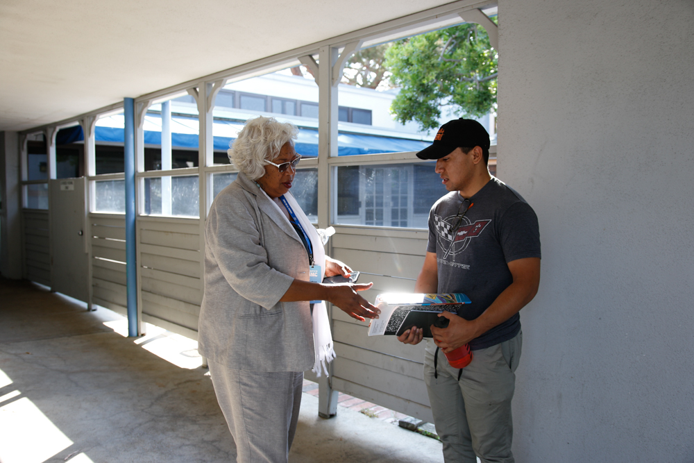 Kathryn Jeffery helps a student looking for EMT classes on the first day of the Fall Semester, Monday August 30, 2016 on the Santa Monica College campus in Santa Monica, Calif. Jeffery ultimately directed the student towards a campus that actually offers EMT courses, as SMC does not.
