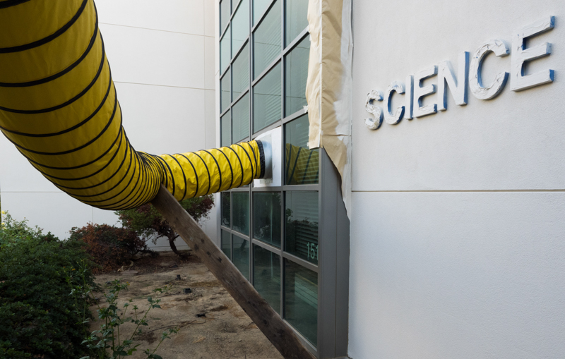 Yellow air conditioning tubes enter a classroom of the Life Science building.