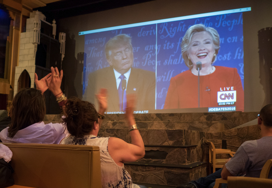 Trump supporters applaud during the Crest Theatre's debate viewing party at the Crest Theatre in Los Angeles, Calif. on Monday, Sept 26, 2016.  The audio and video were not syncronized, making for an odd viewing experience. (Andrew Aono)