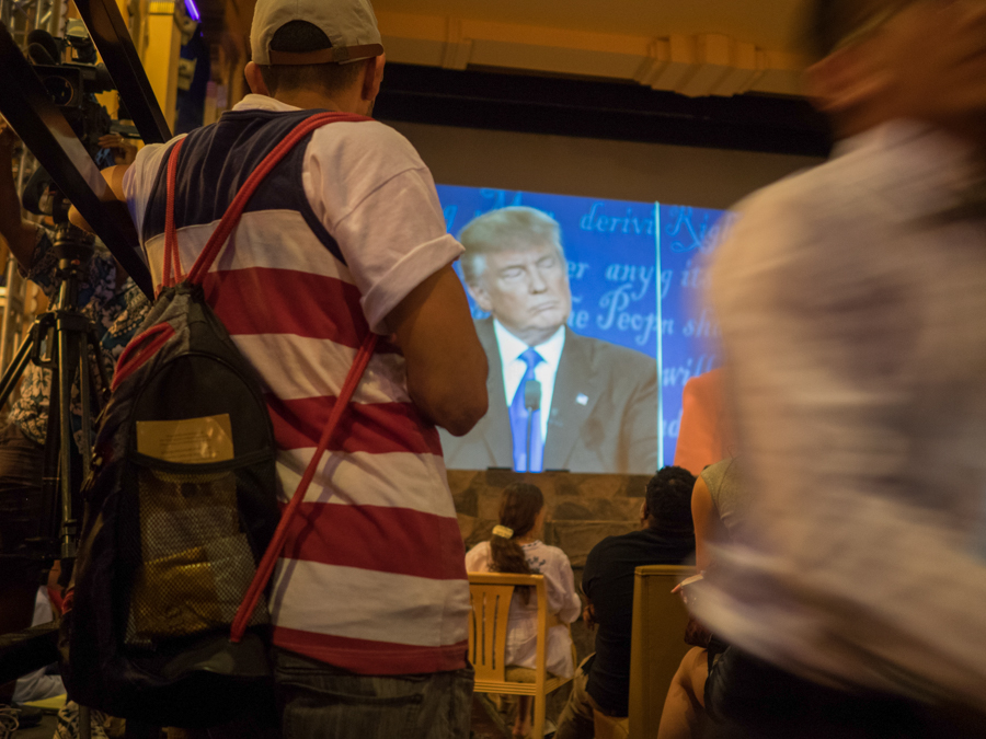 A man in patriotic clothing watches the presidential debate at the Crest Theatre in Los Angeles, Calif. on Monday, Sept. 26, 2016.  The Crest Theatre held a viewing party for the first presidential debate between Hillary Clinton and Donald Trump. (Andrew Aono)