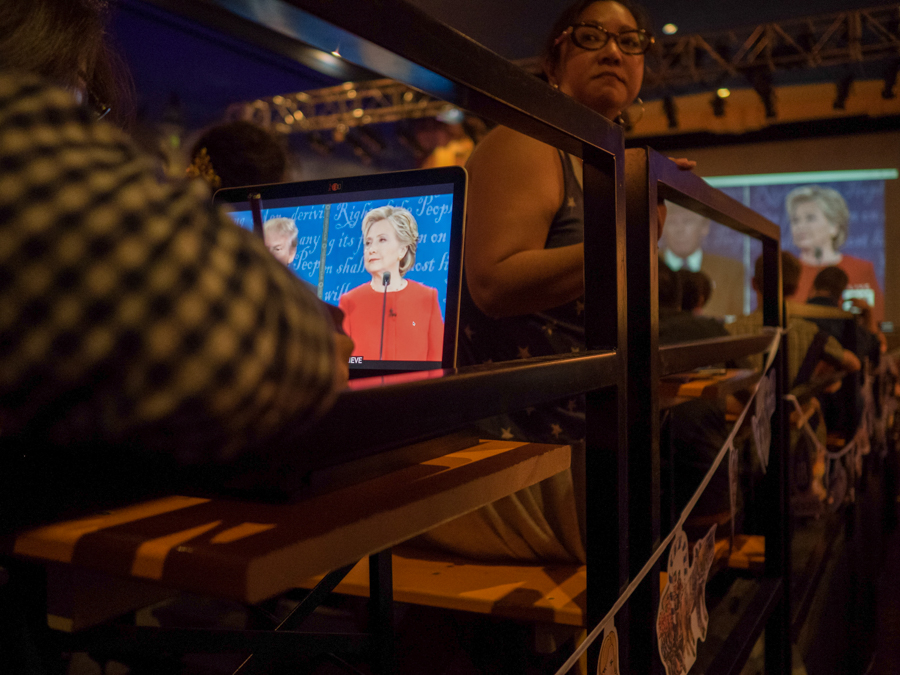 A woman uses her computer to watch the presidential debate at the Crest Theatre in Los Angeles, Calif. on Monday, Sept 26, 2016.  The Crest Theatre held a debate viewing party for the first presidential debate between Hillary Clinton and Donald Trump. (Andrew Aono)