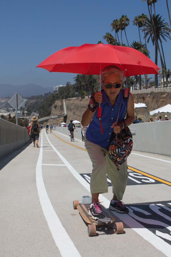 Swee W, Torrance resident, California rides her skateboard on California incline during the Grand opening after a 17-month reconstruction project,  in Santa Monica, California, September 1, 2016.