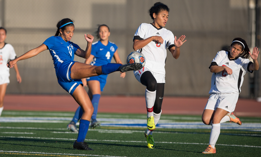 Santa Monica College Corsair Kirsten Ortega (11) attempts a goal kick against Glendale Community College Vaquero Jimena Posadas (17) in the second half. Corsairs win at home 2-0 in Santa Monica, Calif. on October 25, 20016.