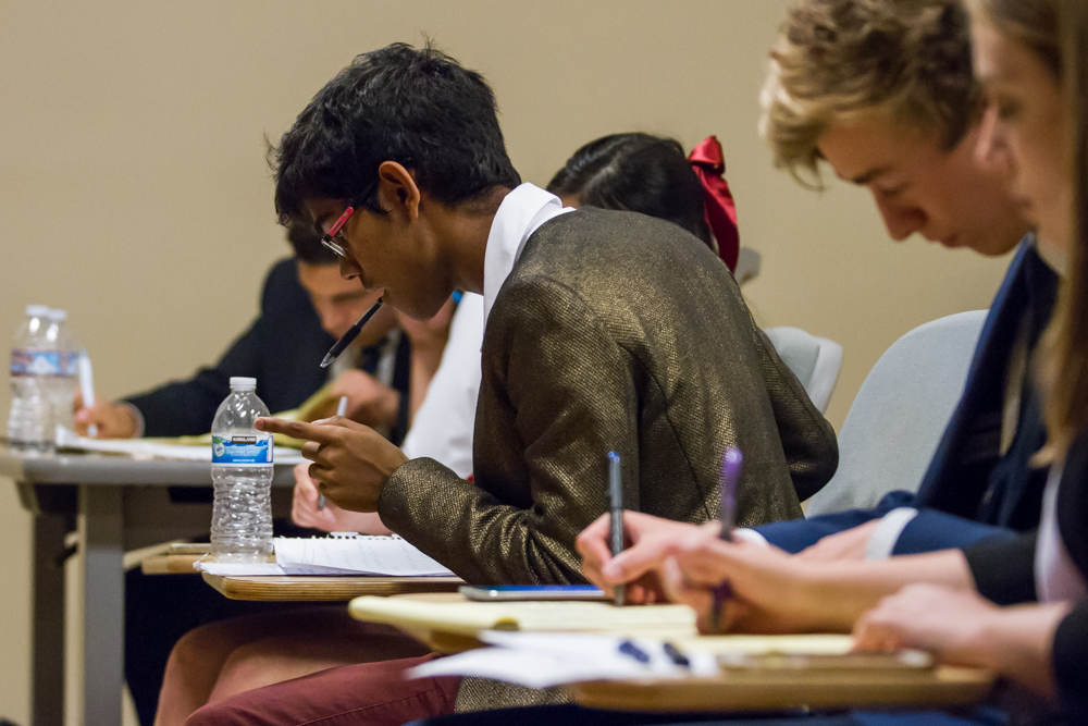 Nishanth Selvalingam, a double major in philosophy and psychology at UCLA, anxiously waits to interject his thoughts to challenge the opposition during the final round of the debate competition held at Santa Monica College in Santa Monica, Calif. on October 28, 2016. Selvalingam won first place in the debate. (Jose Lopez)