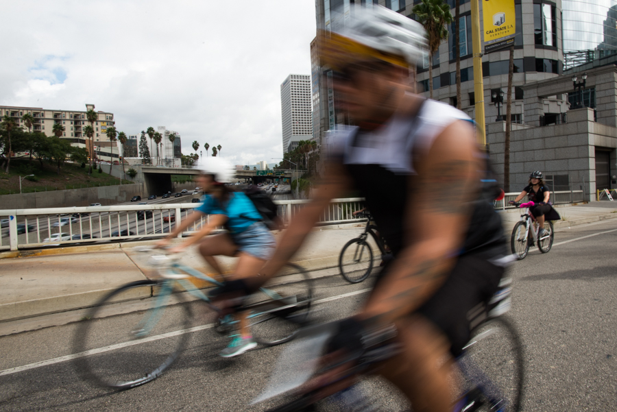 CicLAvia participants ride over the 110 freeway in downtown Los Angeles on Sunday October 16, 2016. CicLAvia closes streets to cars and opens them for cyclists, walkers, and skaters from 9 a.m. to 4 p.m. (Josue Martinez)