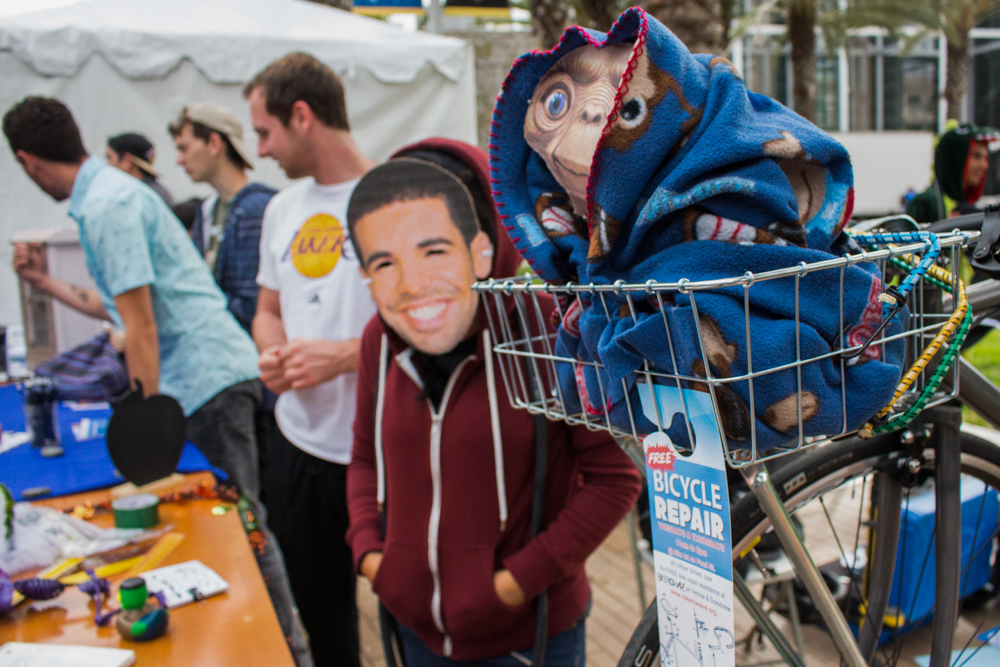 Denisse Martinez, a nutritional science major, promotes the Bycicle Club along side an E.T. prop during the Club Row celebration at Santa Monica College in Santa Monica, Calif. on Thursday, October 27, 2016. (Marisa Vasquez)