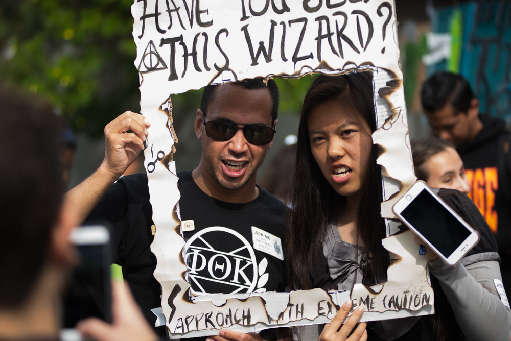 "Ozro Hepworth (left) member of Phi Theta Kappa (PTK) holds up a poster that says ""Have you seen this wizard?"" referring to the Harry Potter novels, while posing for a photo with another member during the Comic-Con Halloween themed Club Row on Thursday, October 27, 2016 on Santa Monica College in Santa Monica, Calif.  PTK is a honor society club on campus which is about creating community on campus. (Rosangelica Vizcarra)"