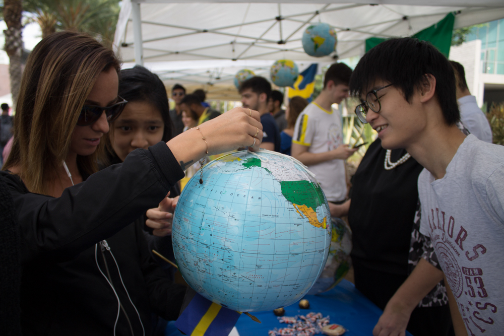 Sam(left), 19, tested students by asking them to show him where Hong Kong is on the globe during Santa Monica College International Day at SMC in Santa Monica, Calif on Tuesday, November 15,2016.  (Brian Quiroz)