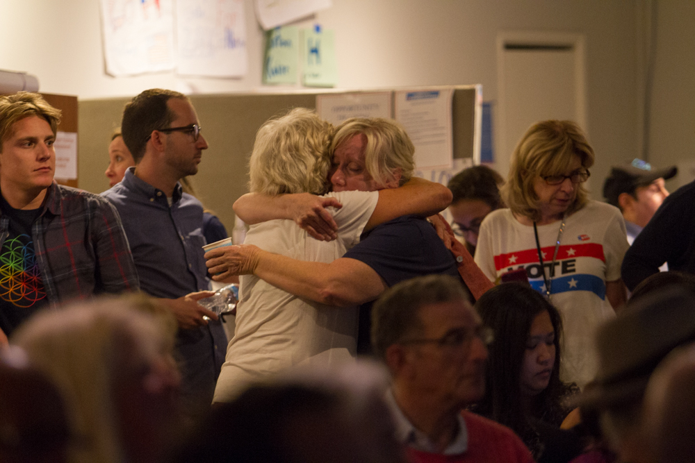 Hillary clinton supporters embrace each other as the tv announcer tells what states trump has won during the presidential election at the Westside Democratic Headquarters in Santa Monica, Calif on Tuesday, November 8, 2016. (Josue Martinez)